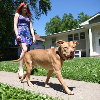 Abby Jacques, 20, of Des Moines, walks her 3-year-old