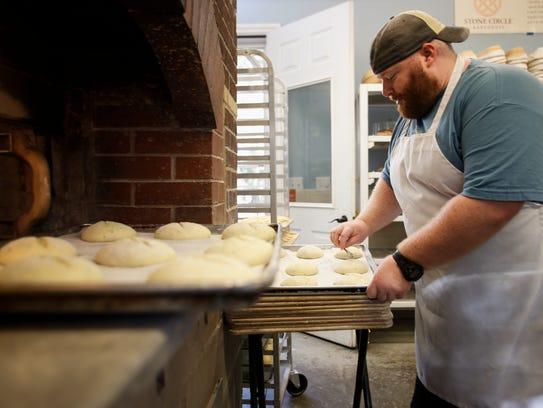 Matt Angell of Stone Circle Bakery scores bread dough
