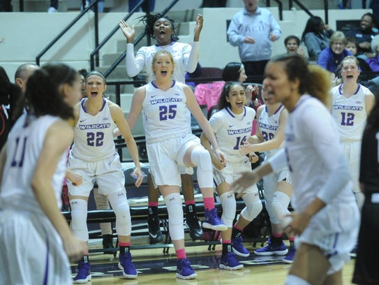 ACU's bench reacts after Sara Williamson's basket gave