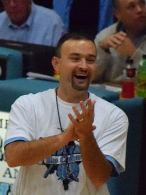 Head Coach Shane Smith laughs during the event.