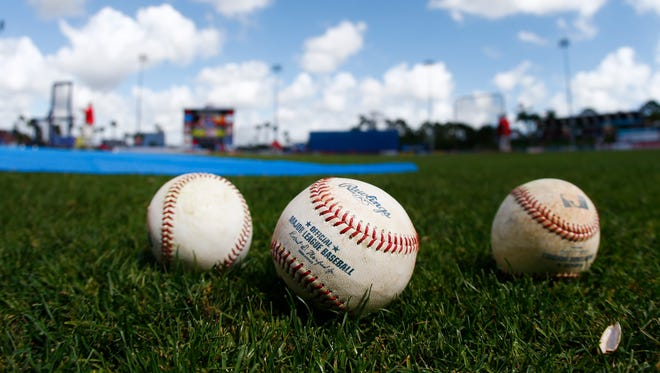 In this March 12, 2015, file photo, baseballs sit shown on the field before an exhibition spring training baseball game between New York Mets and Washington Nationals in Port St. Lucie, Fla. Major League Baseball changed how balls are handled before games this season, adding an extra layer of security in the wake of the Tom Brady flap.