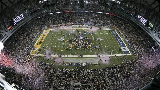 Confetti falls at Super Bowl XL's end at Ford Field on Feb. 5, 2006, with the Steelers defeating the Seahawks 21-10