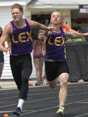 Lexington's Jake Goettel hands the baton off to Tony Gerrell in the 4x100 meter relay as part of a runner-up effort for the Minutemen in Saturday's Division II regional meet at home.