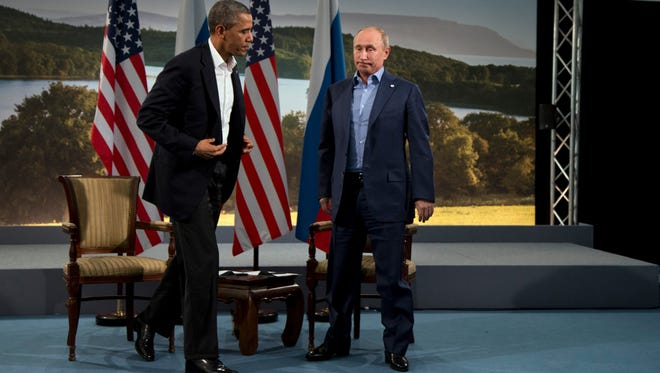 President Obama and Russian President Vladimir Putin leave a meeting in Northern Ireland in 2013.