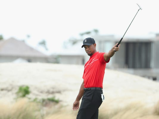 2016-12-4-tiger-woods-club