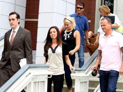 Sarah Jones (second from left)  leaves the Federal Courthouse in July 2013.