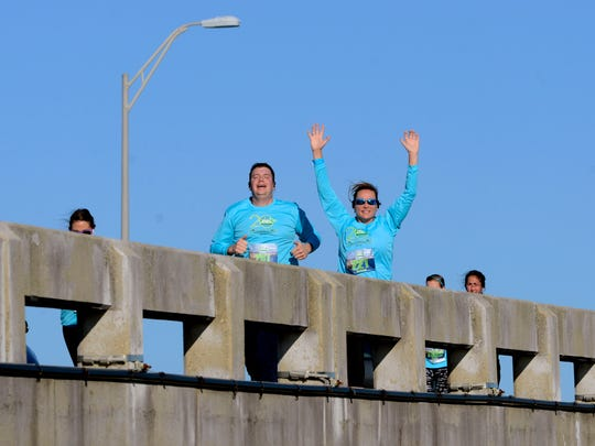 Runners make their way to the finish line Saturday morning during the 20th annual Double Bridge Run.
