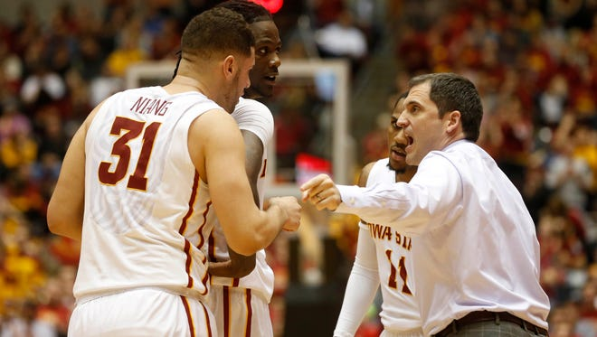 Iowa State coach Steve Prohm talks with Iowa State forward Georges Niang (31), Iowa State forward Jameel McKay (1) and Iowa State guard MontŽ Morris (11) Saturday, Jan. 9, 2016 during their 94-89 loss  to Baylor at Hilton Coliseum in Ames.