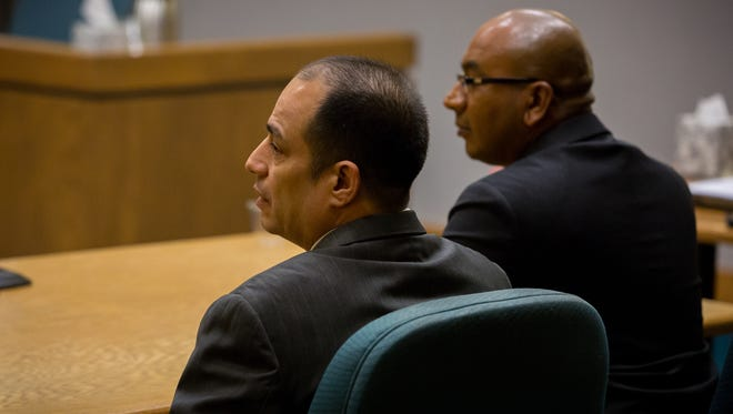 Former El Paso County Judge Anthony Cobos, left, sits next to his defense attorney, Josh Boone, as he is pronounced guilty by Judge Marci Beyer at the Third Judicial District Court in Las Cruces during his embezzlement trial Wednesday.