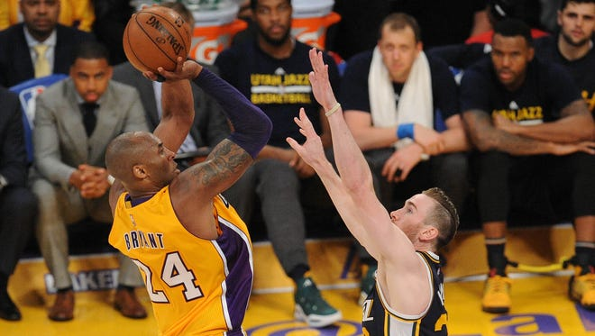 Los Angeles Lakers  forward Kobe Bryant (24) shoots against Utah Jazz forward Gordon Hayward (20) during the second half at Staples Center.