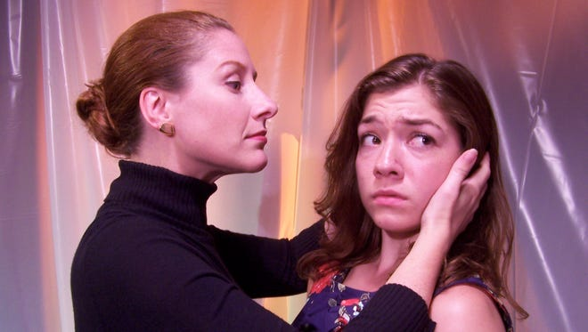 "Alicia Rice and Zoe Schwartz perform in Off the Wall Theatre's production of ""No Exit."""