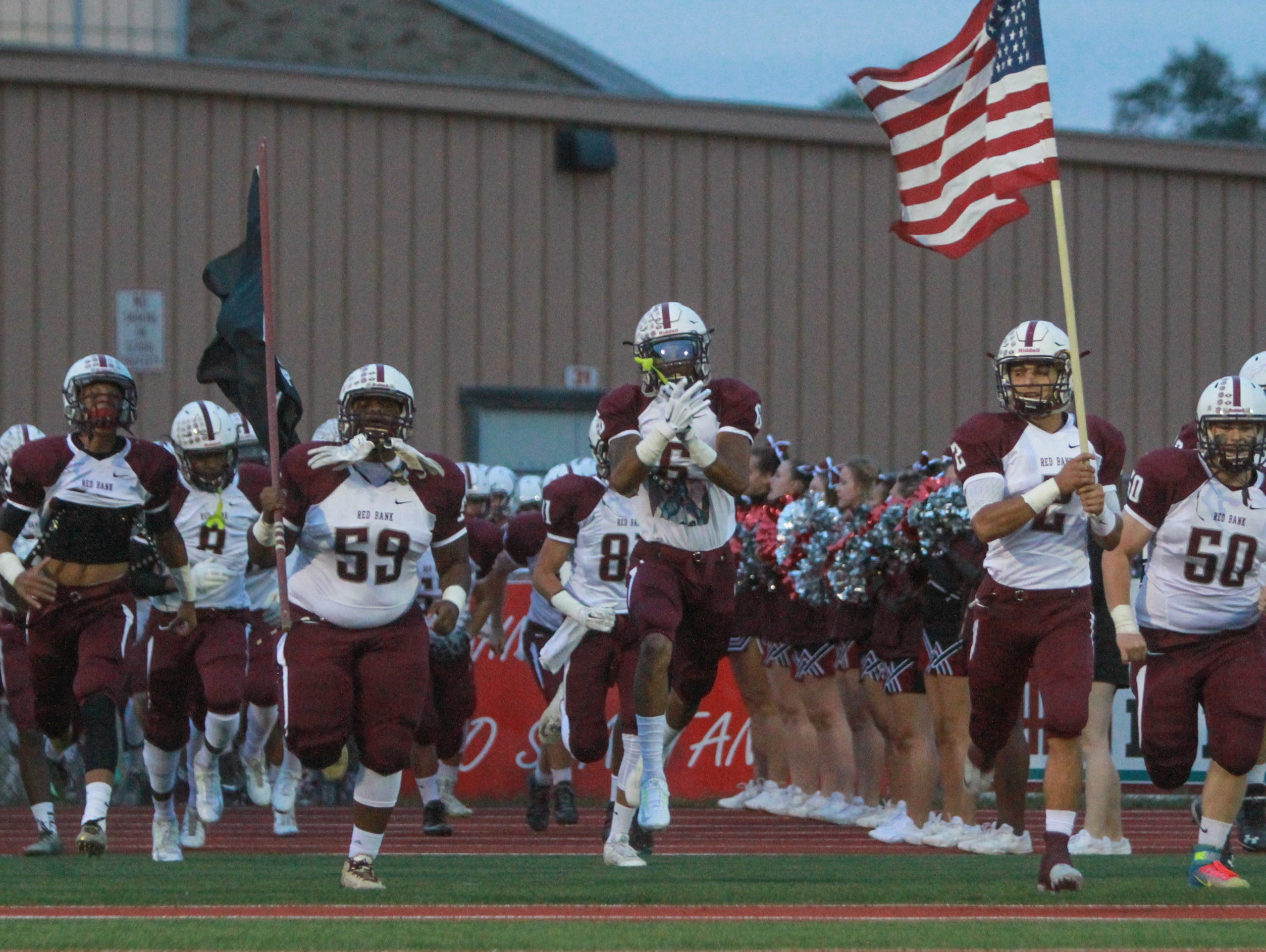 Ocean, NJ Red Bank at Ocean Friday night football. Red Bank enters the field 092415