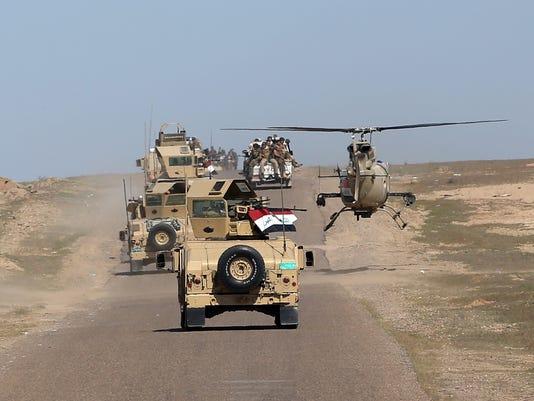 635932230011615494-Mideast-Iraq-Islamic-Alli.jpg