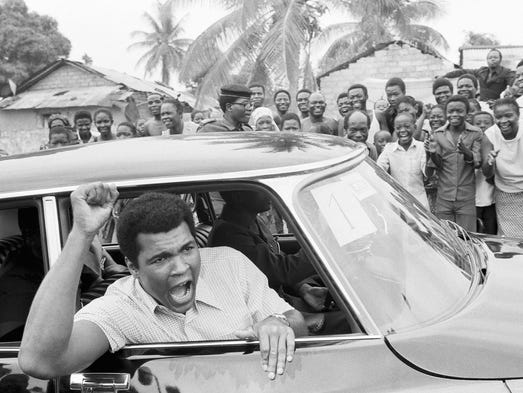 Muhammad Ali calls on the people of Zaire as he drives