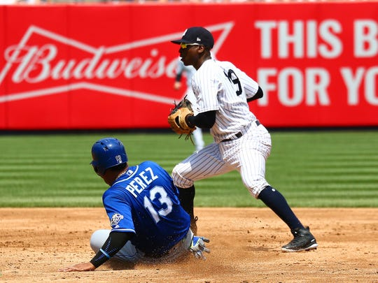 Kansas City Royals catcher Salvador Perez (13) is forced out at second base against the New York Yankees during the fourth inning during the first game of a doubleheader at Yankee Stadium.