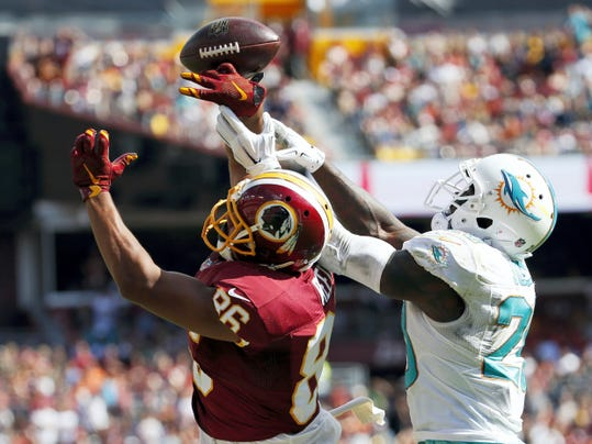 Miami strong safety Reshad Jones (20) breaks up a pass intended for Washington's Jordan Reed during the second half of Sunday's game in Landover, Md.