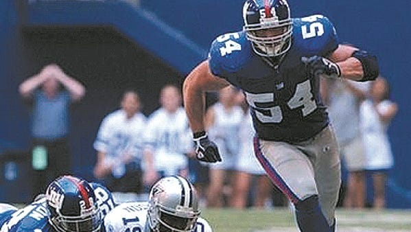 Former Sturgeon Bay and University of Wisconsin star Nick Greisen, shown playing for the NFL's New York Giants in 2005, is now is director of business development for Chicago-based Pro Financial Services.