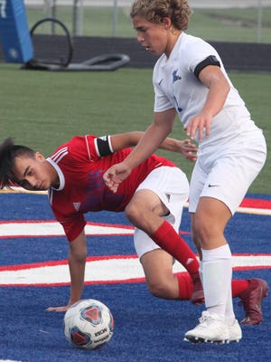 Moberly co-captain Isaiah Lopez braces himself as the Spartan junior slips Tuesday evening while defending Capital City's  Ted Krause while was on the offensive attack near the south goal. The Cavaliers defeated Moberly 6-1.
