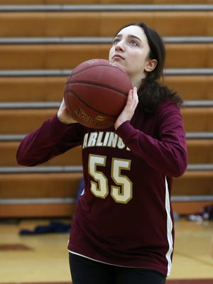 Arlington High School unified basketball player Lindsey Effron puts up a shot during unified team practice in the gym at Arlington High School gym April 12, 2018.