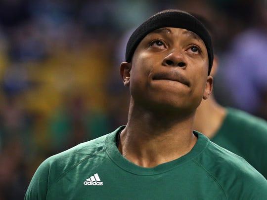 Isaiah Thomas of the Boston Celtics looks on during