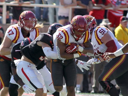 Iowa State Cyclones running back David Montgomery (32) rushes against the Texas Tech Red Raiders in the second half at Jones AT&T Stadium.