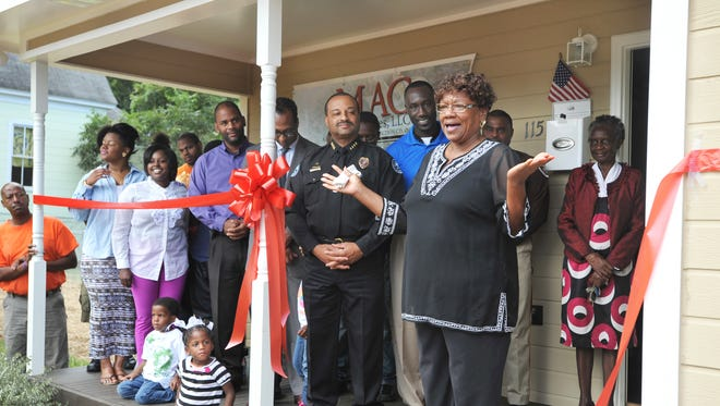Johnnie Johnson, a single mother of 14 children, 11 of them she fostered and then adopted, thanks officials, family and friends after receiving the keys to her newly renovated home on West Street in Jackson. MAC & Associates, LLC rebuilt Johnson home of 19 years after it gutted by fire early this year.