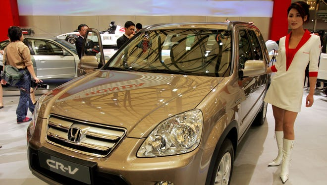 File photo of a Honda CR-V from the 2005 Shanghai auto show. This model is among those in the recalls by three makers today for suspect airbags.