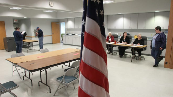 The department criticized a Wisconsin law that requires voters to present photo identification at the polls.