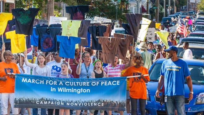 Hundreds marched in the name of peace Saturday in Wilmington.