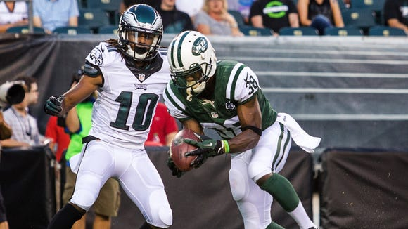 New York Jets corner LeQuan Lewis (No. 38) intercepts a pass intended for Eagles wide receiver Quron Pratt (No. 10) in the first quarter of a preseason football game at Lincoln Financial Field on Thursday night, August 28, 2014.