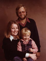 Pat poses with her husband Fred and her son Peter.