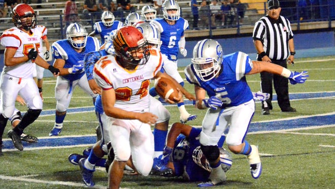 Carlsbad's Carlos Gonzales looks to tackle Centennial's Joaquin Gutierrez on Friday.