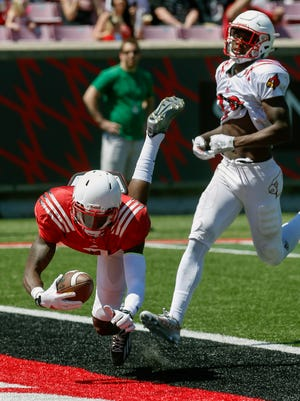 Louisville's Jamari Staples catches Lamar Jackson's 7th touchdowns in the first half of the Spring game Saturday afternoon. April 16, 2016