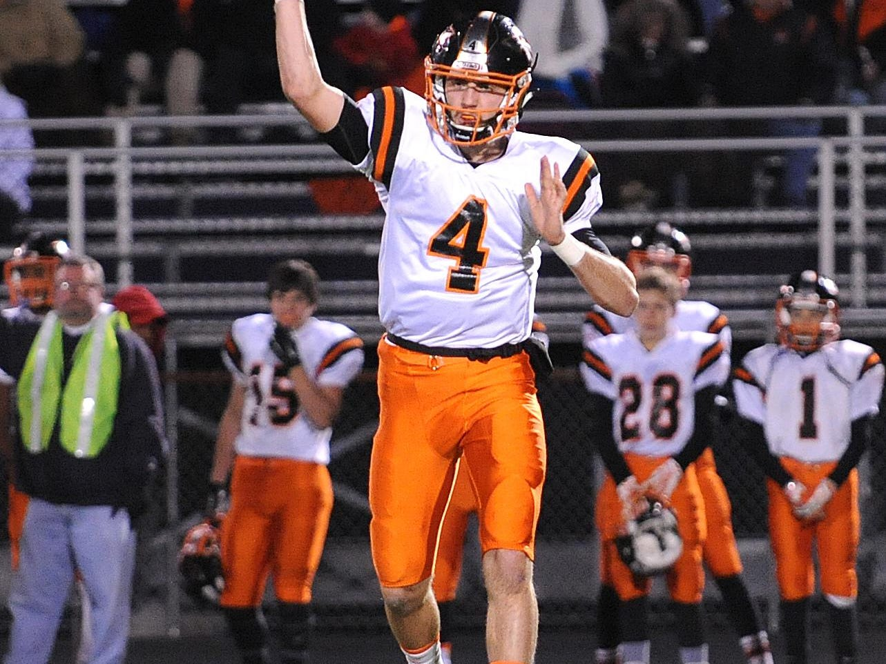 Ashland's Grant Denbow passes the ball Friday night during their game against Lexington.
