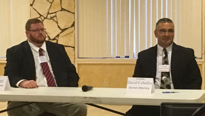 Incumbent DA David Ceballes, right, and challenger John Sugg get ready to take questions Monday night at the county GOP dinner.
