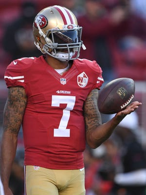San Francisco 49ers quarterback Colin Kaepernick warms up before a game against the Green Bay Packers.