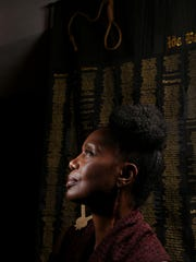 April Shipp of Rochester Hills is showing several of her quilts as part of a group quilt exhibit for Black History Month at Detroit Unity Temple in Detroit. The fiber artist was photographed in front of Strange Fruit, a piece listing names of African Americans who were lynched and murdered between 1865 and 1965.