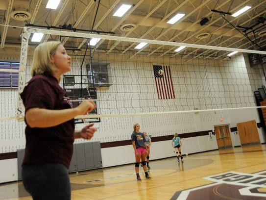 Kim Clark returns as head coach of the Warlassies volleyball
