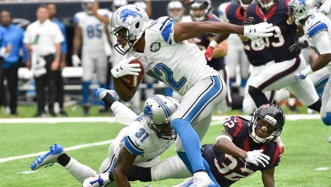 Lions wide receiver Andre Roberts makes a catch against the Texans during the first half on Sunday in Houston.