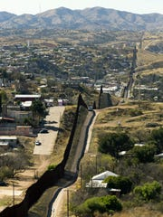 The Mexico-U.S. border fence that separates Nogales, Sonora, left, from Nogales, Ariz., as seen on Feb. 24, 2017.