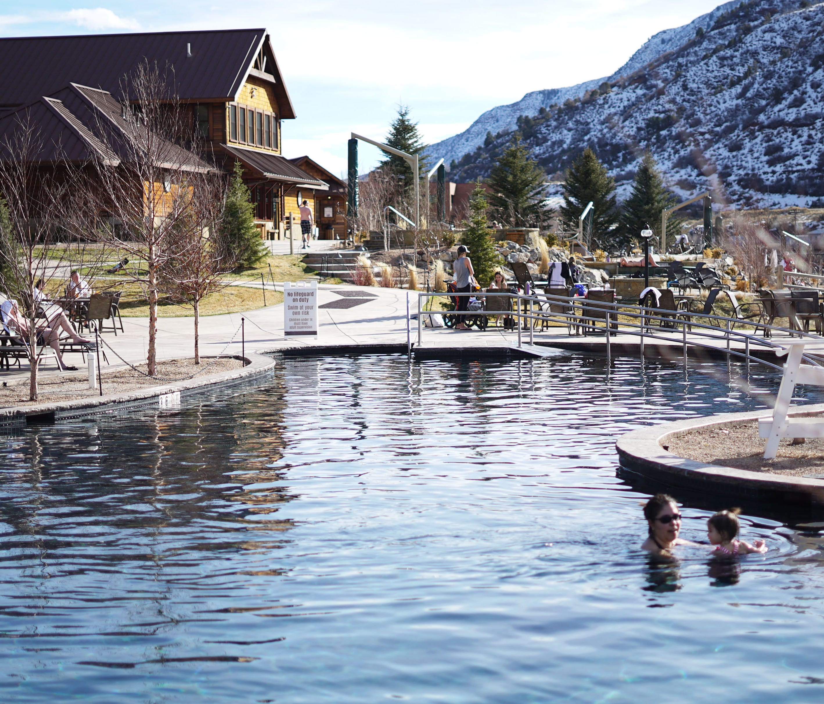 Many hot springs resorts offer both small soaking pools and larger swimming pools, which lower temperatures, suitable for cooling off. Here, bathers soak in the large pool at Iron Mountain Hot Springs.