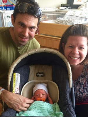 Cadence and Brian Hulme taking their son home from the hospital after 9 days in the NICU on August 20, 2016.