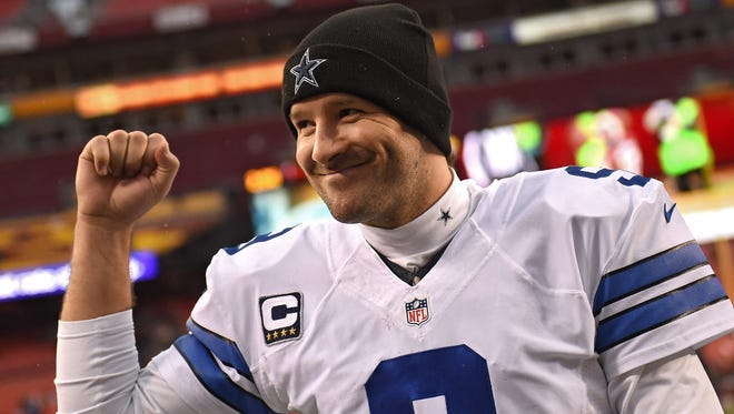 Tony Romo  acknowledges the crowd after the Dallas Cowboys defeated the Washington Redskins at FedExField today. Dallas will host the Lions in a wild card playoff game next week.