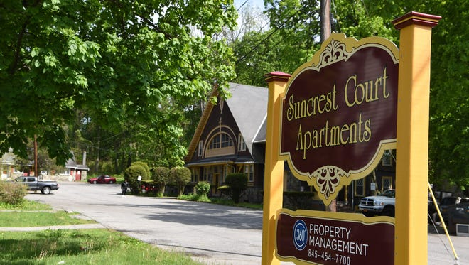 The sign at the entrance to the Suncrest Court Apartments.