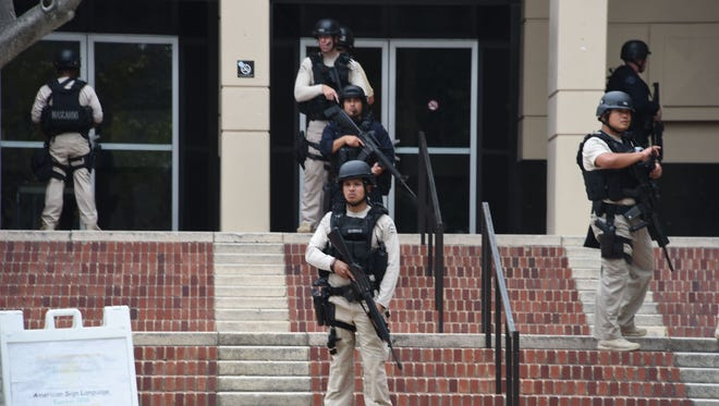Members of security are seen on June 1, 2016, at the University of California's Los Angeles campus.
