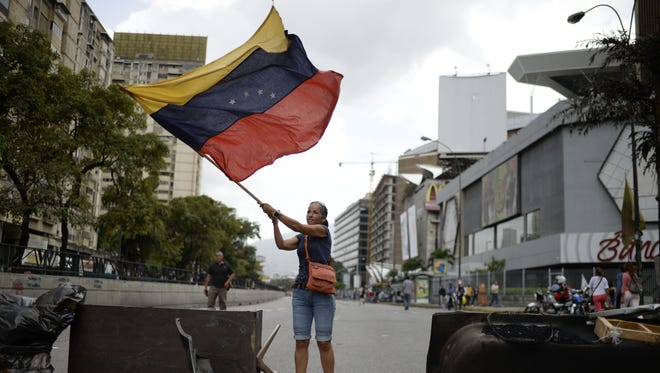 Venezuelan opposition activists protest in Caracas on July 10, 2017.