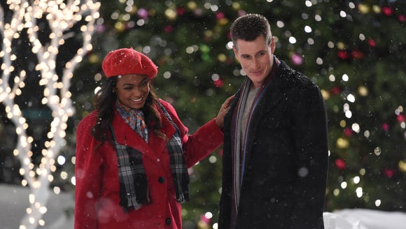Tatyana Ali flirts with Brendan Fehr in 'Wrapped Up