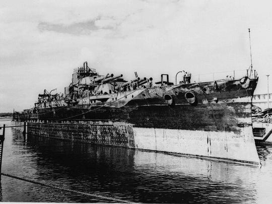The USS Oklahoma leaves the Pearl Harbor drydock Nov. 27, 1944. The ship was sunk at Pearl Harbor in 1941.