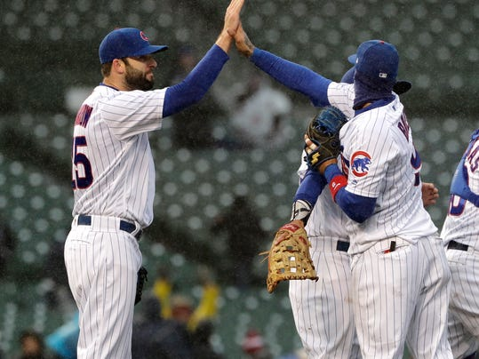 Chicago Cubs closer Brandon Morrow, left, celebrates with Javier Baez after the Cubs defeated the Atlanta Braves 14-10 in a baseball game Saturday, April 14, 2018, in Chicago. (AP Photo/Nam Y. Huh)