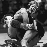 Photos: Four-time wrestling state champions